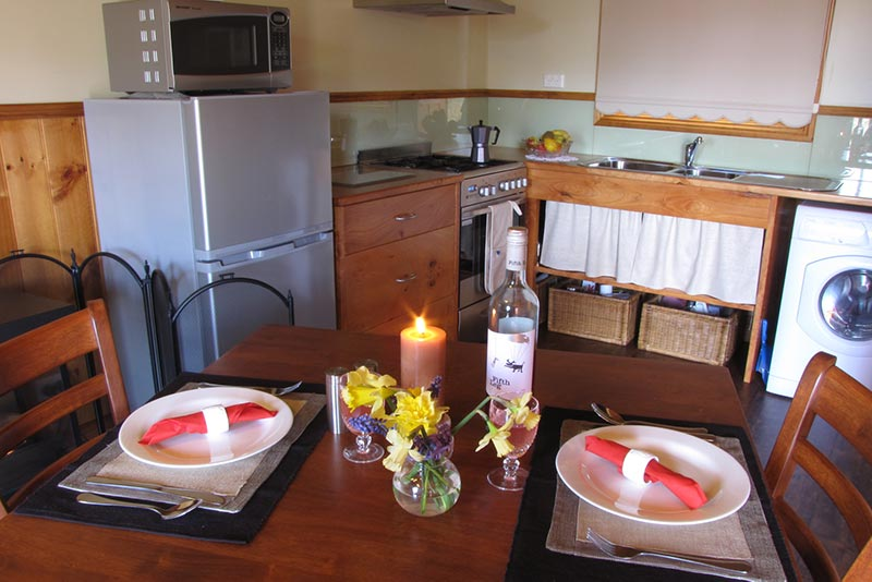 Dining table set up in the well-equipped kitchen