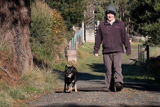 Rusty with Graham enjoying their morning walk at Tin Dragon Cottages