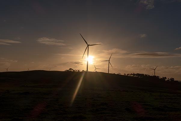 Sun set behind the wind turbines at Little Musselroe Bay, Tasmania