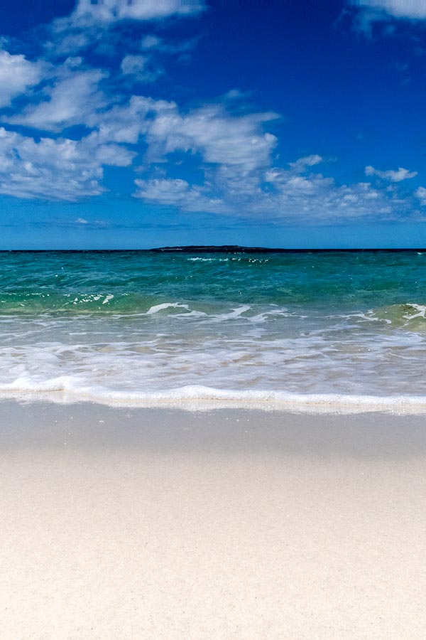 Dazzling white sand and sparkling clear  blue ocean of Little Musselroe Bay, Tasmania