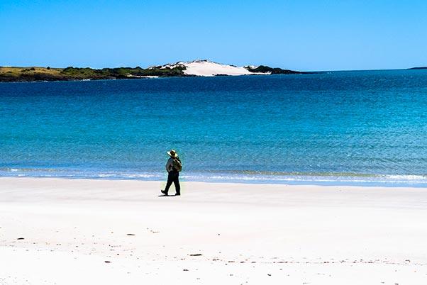 Graham walking on the walk sand beach, Little Musselroe Bay, Tasmania