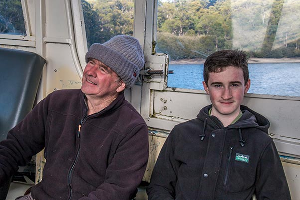 Graham and James sitting in the ferry boat crossing Lake St Clair, Cradle Mountain National Park, Tasmania