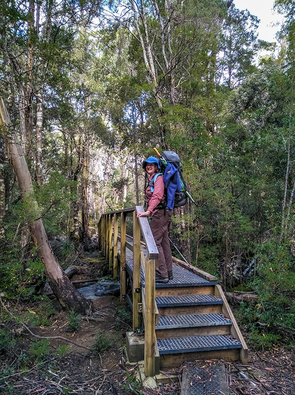 Christine standing on a wooden foot bridge over the Cephissus Creek
