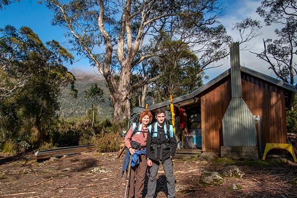 Christine and James with their backpacks at the Narcissus Ranger hut, Lake St Clair, Tasmania