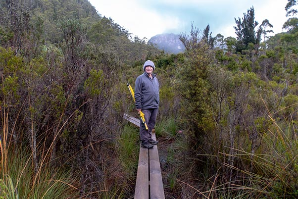 Graham standing on the boardwalk outside the Lake Vera Hut
