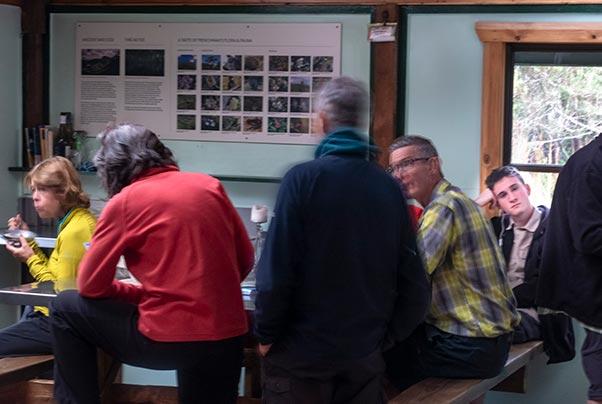 People sitting around the table  inside Lake Vera Hut