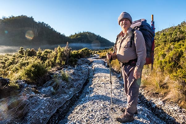 Early morning on Rumney Plain. Graham standing on the white granite track.