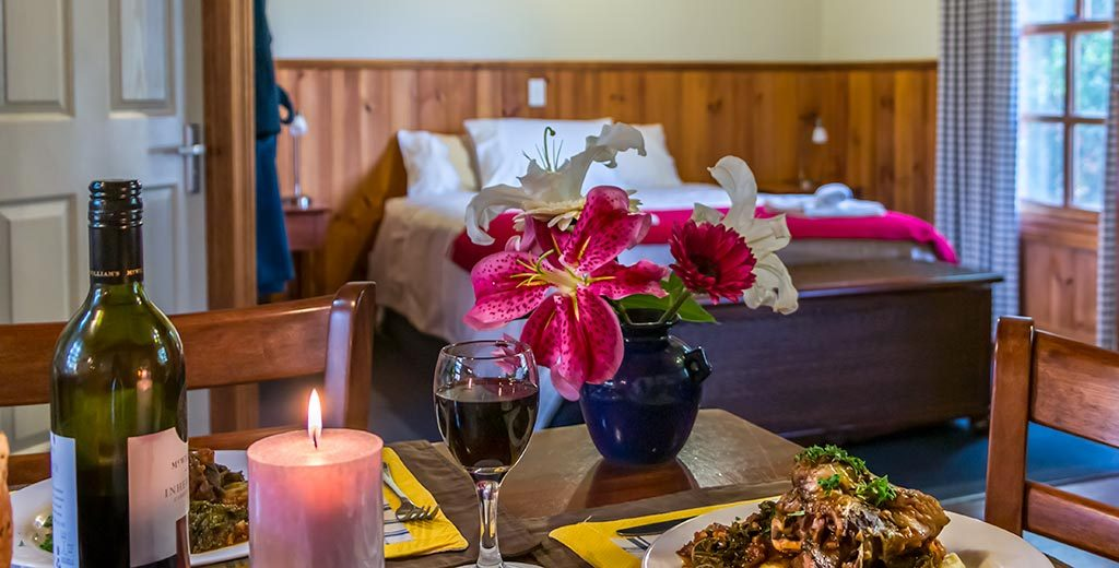 For your romantic winter getaway in Tasmania there is a warming winter casserole and wine on the table inside a studio spa cottage.