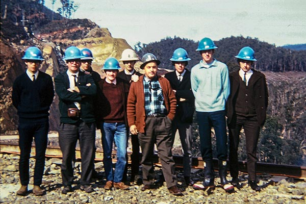 19602 photo of Graham with other employees of Hydro Tasmania. They are wearing hard hats..