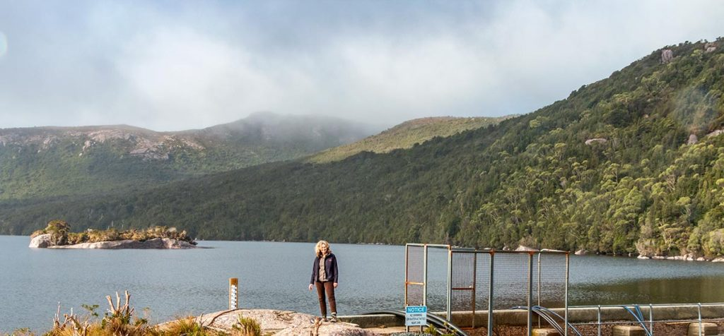 Christine standing on the Lake Margaret dam wall in west Tasmania