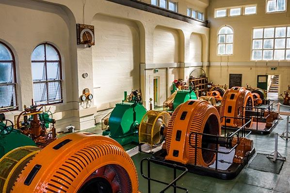Three large turbines generating ower inside the lake Margaret Power Station