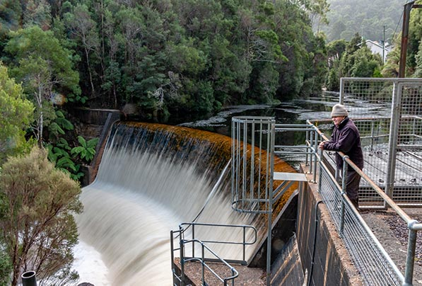 Graham standing on top of the weir below the lake Margaret Power Station