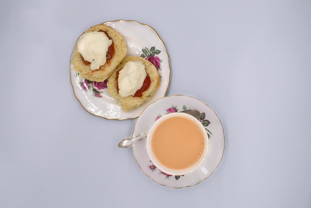 Devonshire tea served on rose china.
