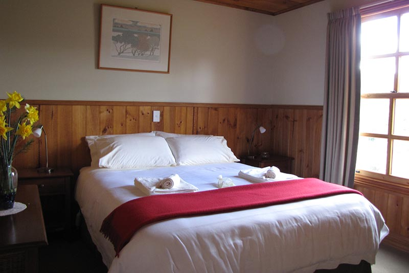 The main bedroom in Ah Ping cottage includes a queen-sized bed.