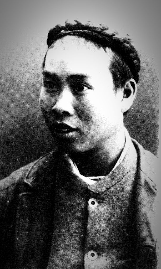 Old black and white portrait of a young Chinese man. This Chinese immigrant has become the face of Henrys story.