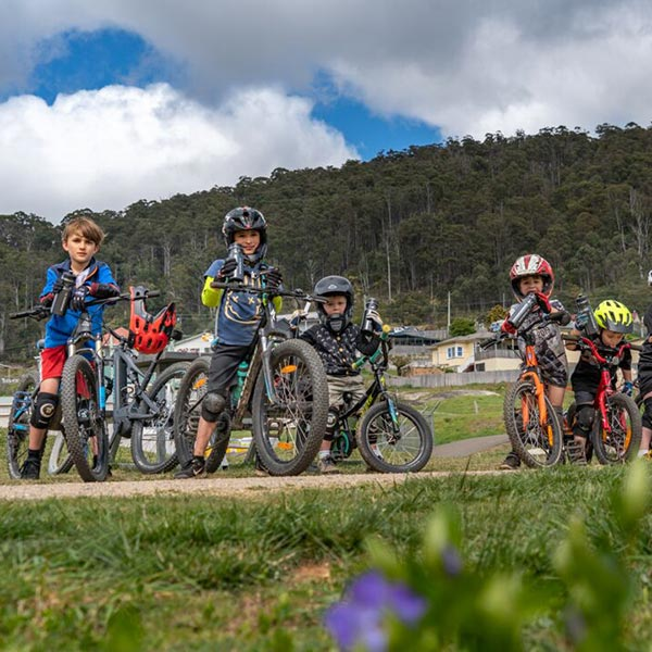 A group of child mountain-bike riders in Derby, Tasmania