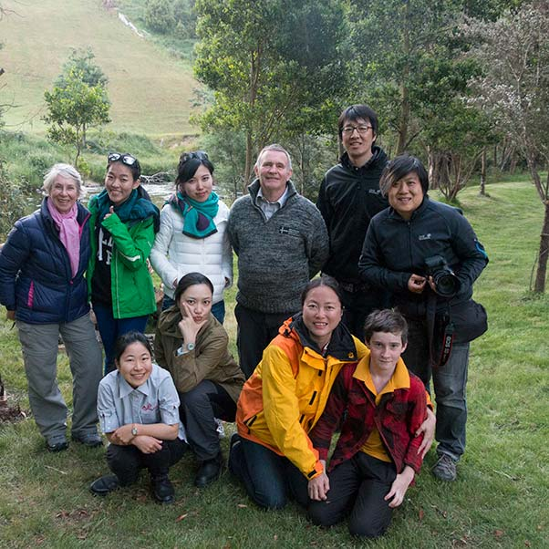 Film crew from World Traveler with their interpreter  posing near the Ringarooma River at Tin Dragon Cottages.