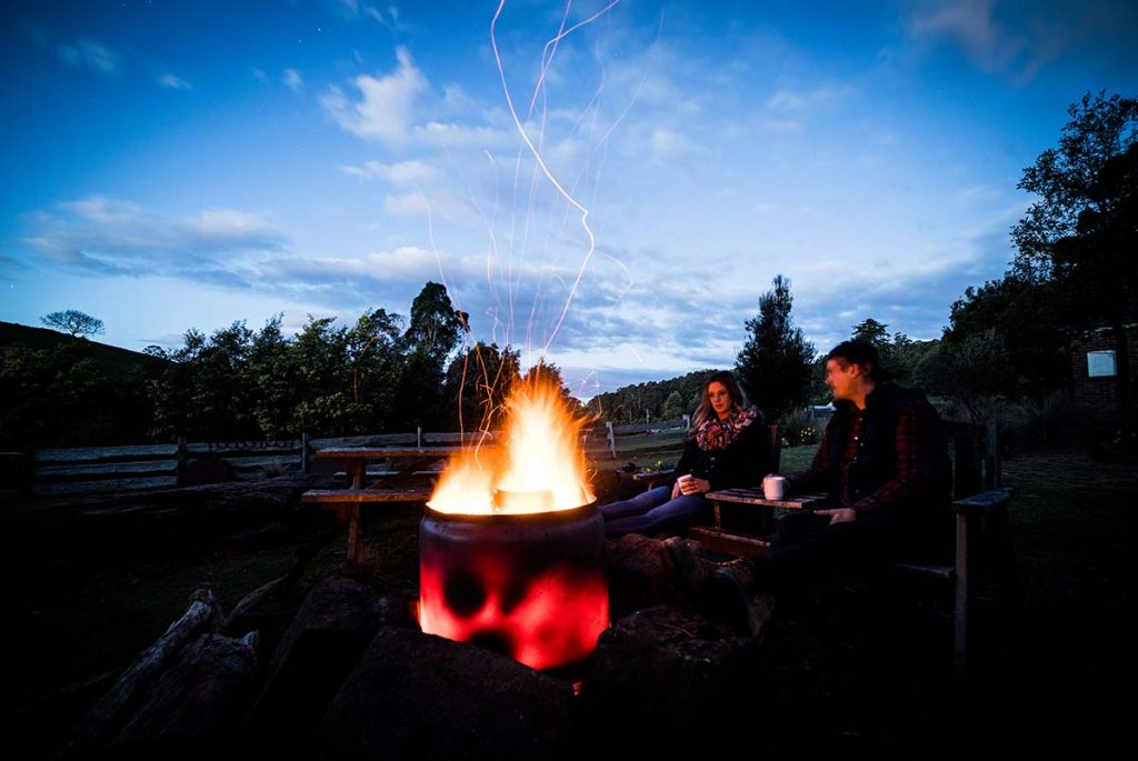 Romantic getaway at Tin Dragon Cottages gazing into the fire pot.