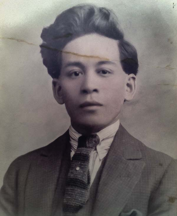 Young Chinese gentleman in a suit and tie (C 1920's is Chung Fon Hock, son of Foon Hock.