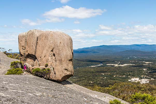 Walking towards cube rock over the granite slab.