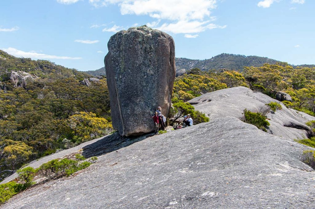 Cube rock is in profile view. Our group standing near the rock shows how massive the rock is.