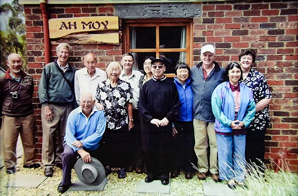 Ah Moy family in 2008 standing outside ah Moy cottage at Tin Dragon Cottages. The Ah Moy family were important in Henrys story.