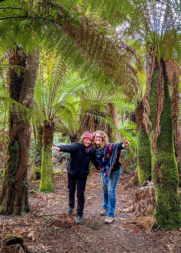 Two women standing on a path in the Myrtle Forest, North East Tasmania.